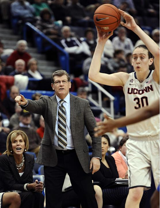 FILE -- In this Jan. 22, 2014 file photo, Connecticut coach Geno Auriemma gestures as Breanna Stewart looks to pass during the second half of an NCAA college basketball game against Memphis in Hartfor