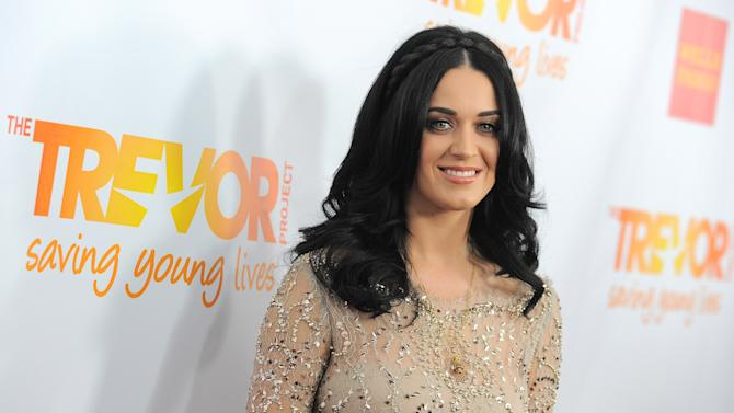 FILE - In this Dec. 2, 2012 file photo, Katy Perry arrives at Trevor Live at the Hollywood Palladium, in Los Angeles.  Kelly Clarkson and fun. are just two of the acts who will perform during the upcoming inaugural festivities, which also includes Beyonce, James Taylor, Stevie Wonder, Katy Perry and dozens of others. (Photo by Jordan Strauss/Invision/AP, File)