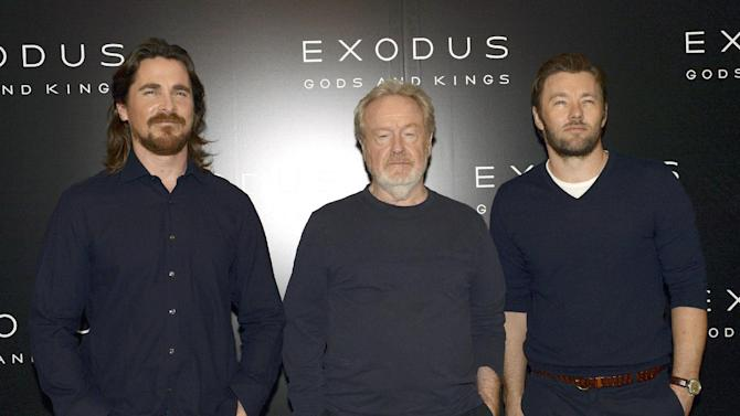 Actors Christian Bale (L), Joel Edgerton (R) and film director Ridley Scott pose during a photocall for Scott's film 'Exodus: Gods and Kings', in Paris, on December 2, 2014
