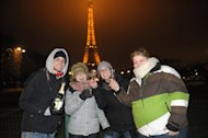 People celebrate New Year's Even with champagne near the Eiffel Tower in Paris last year. ne of the world's oldest shared traditions, New Year's celebrations take many forms, but most cultures have one thing in common -- letting one's hair down after a long, hard year