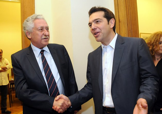 Greek leader of Coalition of the Radical Left party (SYRIZA), Alexis Tsipras, right, and leader of the Democratic Left party, Fotis Kouvelis, smile before their meeting at the Greek Parliament in Athens, Tuesday, May 8, 2012. Greece&#39;s commitment to austerity is no longer valid because voters have rejected those deals, Tsipras declared Tuesday as he tried to form a new coalition government. (AP Photo/Evi Fylaktou)