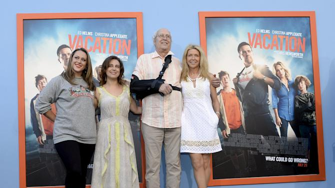 """Cast member Chevy Chase, wife Jayni Chase and daughters Emily Chase and Caley Chase pose during the premiere of the film """"Vacation"""" at the Regency Village Theatre in the Westwood section of Los Angeles"""