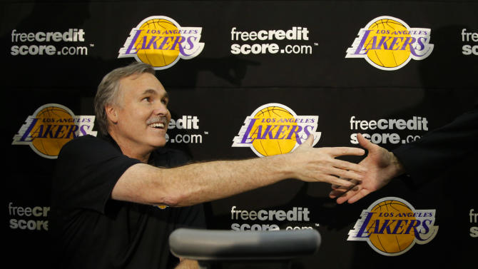 New Los Angeles Lakers coach Mike D'Antoni shakes hands with a well-wisher after a news conference at the team's NBA basketball training facility in El Segundo, Calif., Thursday, Nov. 15, 2012. Although D'Antoni is still on crutches after his recent knee surgery, he is already at work with the Lakers. (AP Photo/Jae C. Hong)