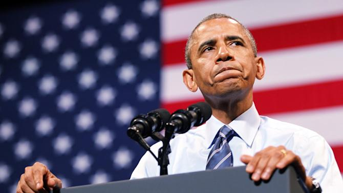 President Barack Obama pauses during his speech on the economy at the Paramount Theatre in Austin, Texas, Thursday July 10, 2014. (AP Photo/The Dallas Morning News, Kye R. Lee, Pool)