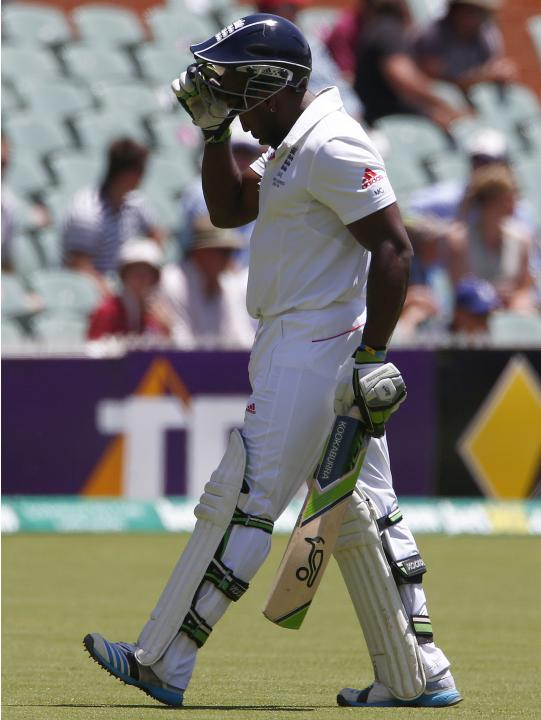 England's Carberry walks off the field after he was caught out by Australia's Warner during the third day of the second Ashes test cricket match in Adelaide