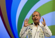 Mexico's President Felipe Calderon delivers a speech during the opening ceremony of the CEO's Summit of the Americas in Cartagena, Colombia
