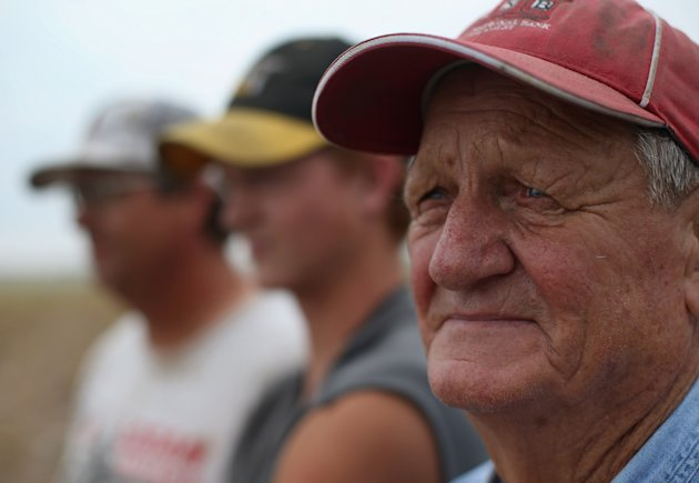 LOGAN, KS - AUGUST 24:  Three generations of Becker farmers - Loyd, 86, Charlie, 19, and Darren, 47 stand in drought parched field on the Becker farm August 24, 2012 in Logan, Kansas. Like many Kansas farmers affected by the record drought, the Beckers are working hard to hang on to their farm, which has been in their family for five generations. Most of Kansas is still in extreme or exceptional drought, despite recent lower temperatures and thunderstorms, according to the University of Nebraska's Drought Monitor. The record-breaking drought, which has affected more than half of the continental United States, is expected to drive up food prices by 2013 due to lower crop harvests and the adverse effect on the nation's cattle industry.  (Photo by John Moore/Getty Images)