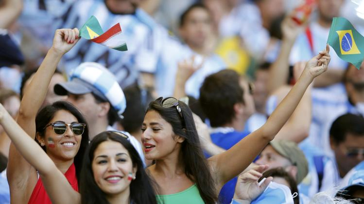 Fans cheer before the 2014 World Cup Group F soccer match between Argentina and Iran at the the Mineirao stadium