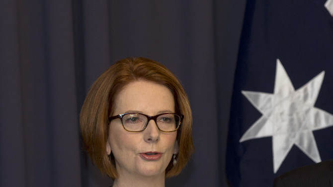 Australia's prime minister Julia Gillard makes a statement to the media after a leadership ballot in Canberra, Australia, Thursday, March 21, 2013. Gillard remains Australia's prime minister after she threw her job open to a leadership ballot but no one from the government was willing to run against her. (AP Photo/Rob Griffith)