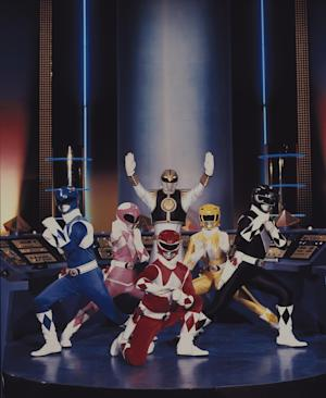 """FILE - This publicity file photo provided by Saban Brands, shows a scene from the """"Mighty Morphin Power Rangers"""" TV show. Lions Gate Entertainment Corp. said Tuesday, May 6, 2014, it was partnering with Haim Sabanís Saban Entertainment to produce a live-action feature film based on the spandex-wearing, martial arts superheroes who are usually called upon to save the world. """"Power Rangers"""" have had a continuous presence on U.S. TV since 1993. (AP Photo/Saban Brands, file)"""