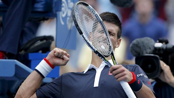 Djokovic of Serbia celebrates after defeating Seppi of Italy in their third round match at the U.S. Open Championships tennis tournament in New York