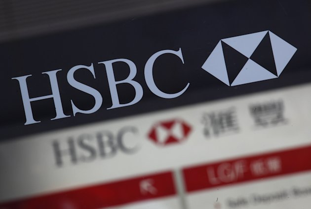 Company logos of HSBC are displayed at one of its branches in Hong Kong