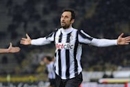 Juventus' forward of Montenegro Mirko Vucinic (L) celebrates after scoring during the Italian Serie A football match Bologna against Juventus in Bologna stadium. Juventus maintained their unbeaten run this season but fell behind AC Milan in the Serie A title race following a 1-1 draw at Bologna on Wednesday