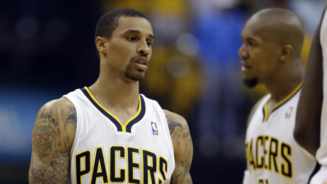 Indiana Pacers' George Hill gets ready for the start of Game 6 of an Eastern Conference semifinal NBA basketball playoff series against the New York Knicks Saturday, May 18, 2013, in Indianapolis. (AP Photo/Darron Cummings)