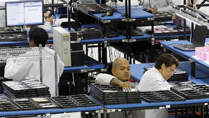 Workers assemble Motorola phones at the Flextronics plant in Fort Worth, Texas