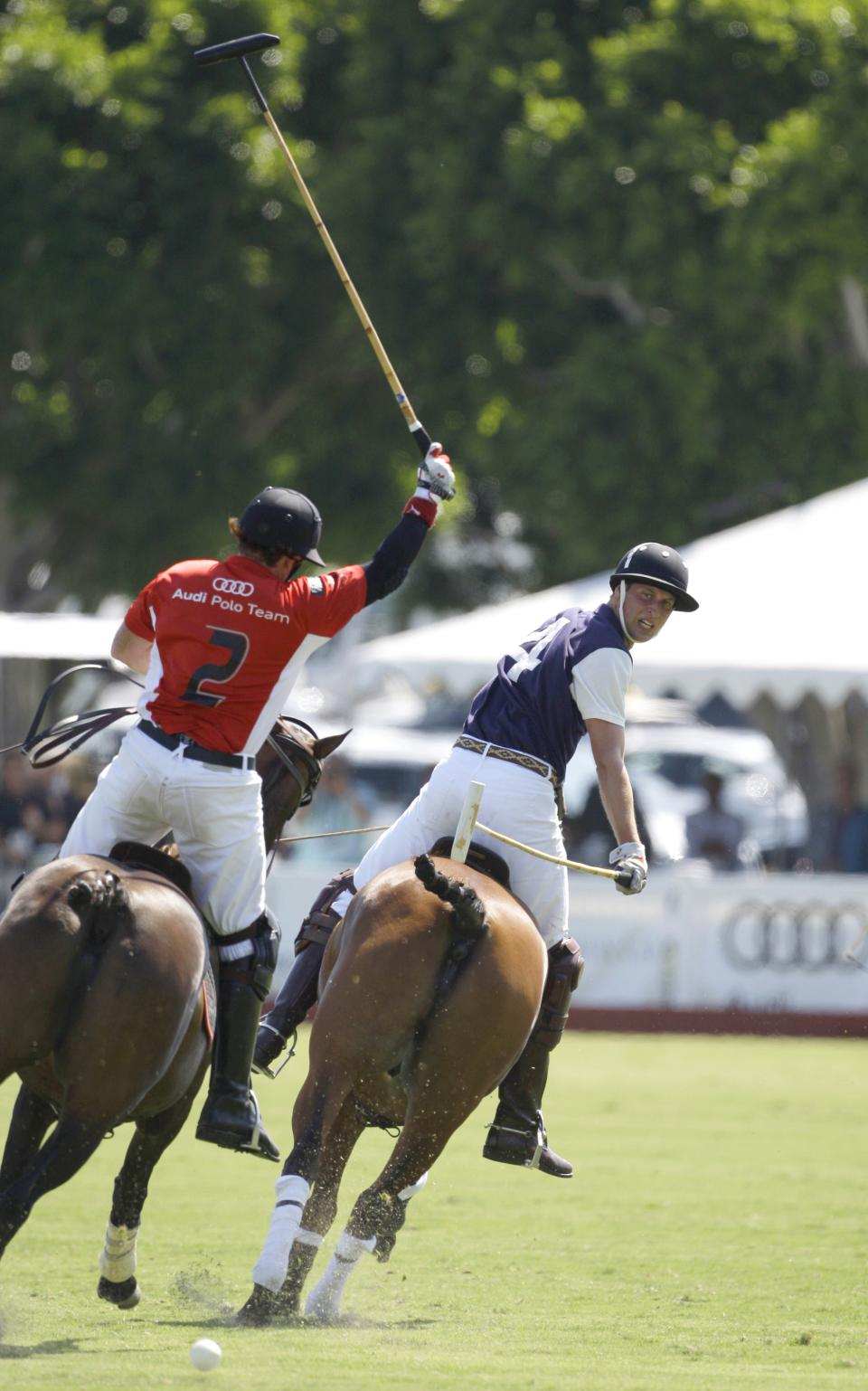 Prince William, Duke of Cambridge, right, competes in a charity polo match at The Santa Barbara Polo & Racquet club on Saturday, July 9, 2011 in Carpinteria Calif.  The event is held in support of The American Friends of The Foundation of Prince William and Prince Harry. (AP Photo/Reed Saxon)