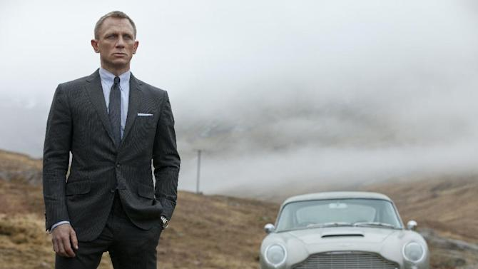 """This film image released by Columbia Pictures shows Daniel Craig as James Bond in the action adventure film, """"Skyfall.""""  Every year fashion offers up the good, the bad and the ugly. But what the industry is really built on _ and consumers respond to _ is buzz. Craig's wardrobe in """"Skyfall"""" is impeccably tailored and quite tight. Unlike the James Bonds that came before him who all liked the traditional looser, longer cut of a Savile Row-style suit, Craig, whose wardrobe is created mostly by Tom Ford, takes his suits Euro style with tapered legs and shorter rises. (AP Photo/Sony Pictures, Francois Duhamel)"""