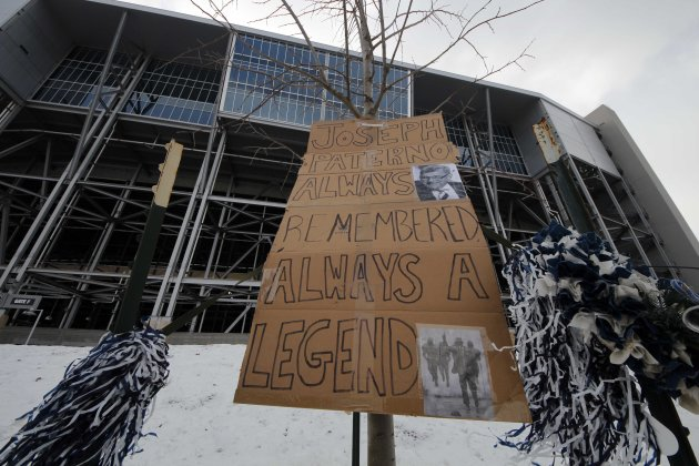A sign of support is displayed near the site where a bronze statue of former Penn State head coach Joe Paterno once stood outside Beaver Stadium in State College, Pa., Tuesday, Jan. 22, 2013. Supporte