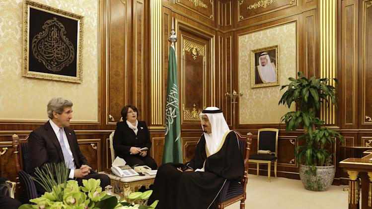 U.S. Secretary of State John Kerry, left, meets with Saudi Deputy Foreign Minister Prince Abdulaziz bin Abdullah at Yamamah Palace in Riyadh, Saudi Arabia on Monday, March 4, 2013. Saudi Arabia is the seventh leg of Kerry's first official overseas trip. (AP Photo/Jacquelyn Martin, Pool)