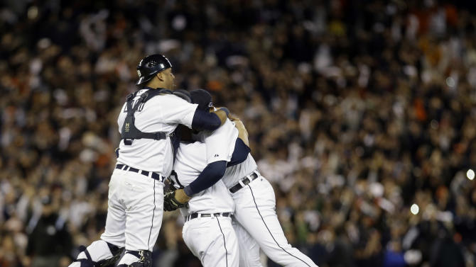 From left, Detroit Tigers' Gerald Laird, Phil Coke and Jhonny Peralta celebrate after winning Game 4 of the American League championship series 8-1, against the New York Yankees, Thursday, Oct. 18, 2012, in Detroit. The Tigers move on to the World Series. (AP Photo/Paul Sancya )