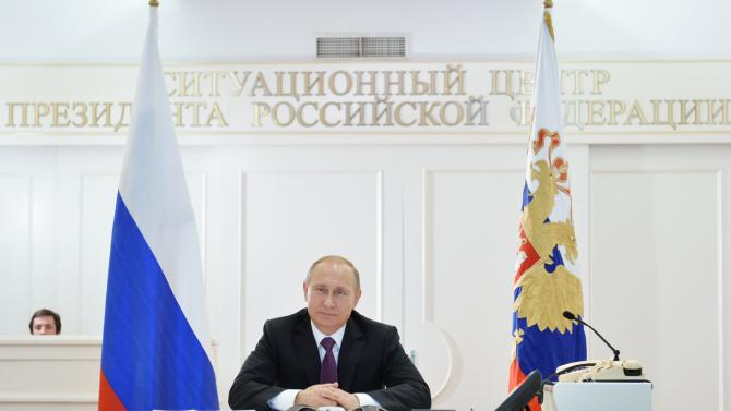 Russian President Vladimir Putin takes part in a video conference with members of Russian Geographical Society expedition to the Southern Pole in Moscow