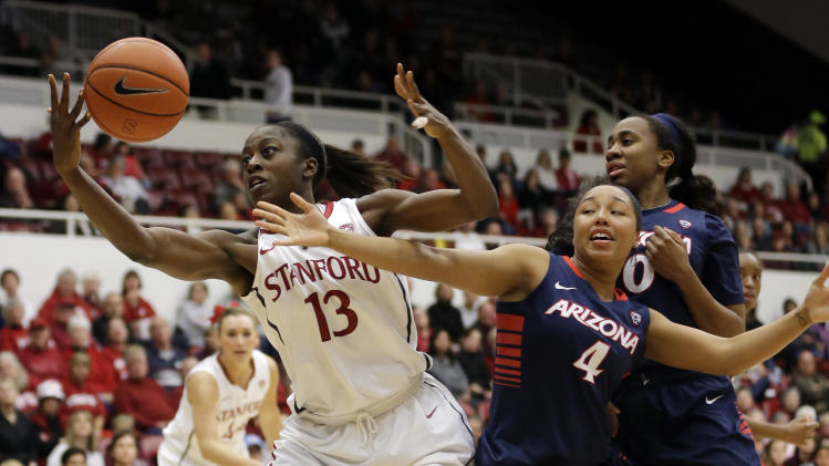 Stanford 's Chiney Ogwumike (13) grabs a rebound next to Arizona 's Carissa Crutchfield (4) and Alli Gloyd, right, during the first half of an NCAA college basketball game in Stanford, Calif., Friday, Feb. 8, 2013. (AP Photo/Marcio Jose Sanchez)
