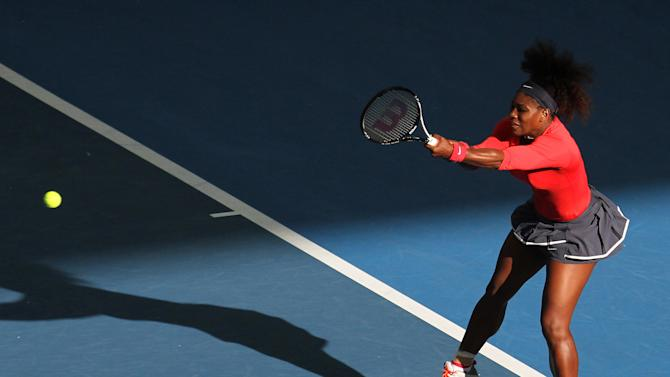 Serena Williams of the U.S. plays a shot during her first round match against Varvaro Lepchenko of the U.S. during the Brisbane International tennis tournament in Brisbane, Australia, Sunday, Dec. 30, 2012.  (AP Photo/Tertius Pickard)