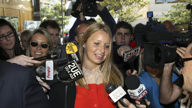 Madeleine Pulver arrives at the New South Wales State District Court, in Sydney, Australia, Tuesday, Nov. 20, 2012, for the sentencing of Paul Douglas Peters, an Australian investment banker who admitted chaining a fake bomb to Pulver in Aug. 2011, as part of a bizarre extortion plot. Peters pleaded guilty to the crime and was sentenced to 13 years and six months jail Tuesday.   (AP Photo/Rob Griffith)