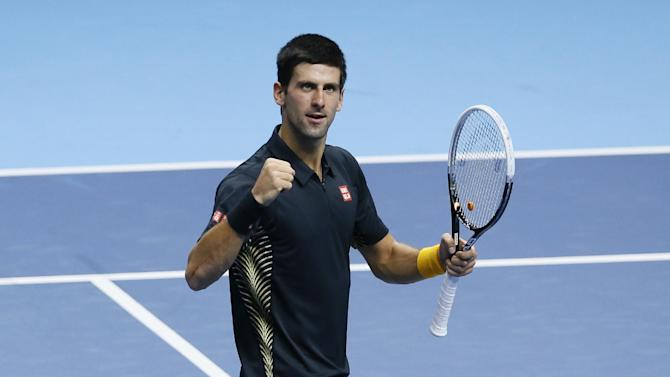 Novak Djokovic of Serbia celebrates after beating Jo-Wilfried Tsonga of France during their singles tennis match at the ATP World Tour Finals in London Monday, Nov. 5, 2012. (AP Photo/Kirsty Wigglesworth)