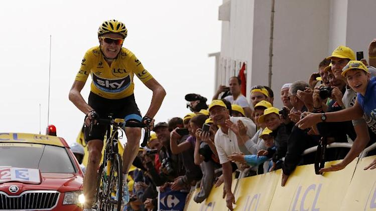 Britain's Christopher Froome celebrates as he crosses the finish line at the end of the 15th stage of the Tour de France on July 14, 2013