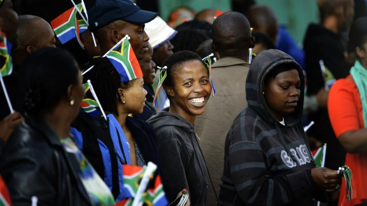 A woman smiles as she queues for a security check at the Union Buildings in Pretoria