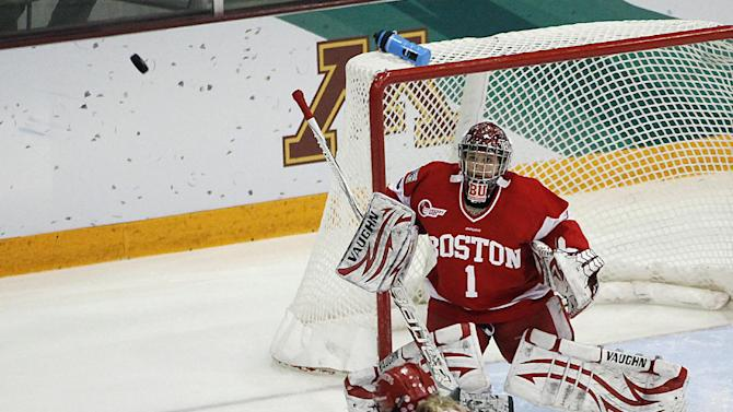 Minnesota forward Bethany Brausen (16) takes a shot at Boston University goalie Kerrin Sperry (1) in the women's Frozen Four NCAA Championship college hockey game, Sunday, March 24, 2013, in Minneapolis. (AP Photo/Stacy Bengs)