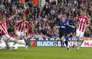 Manchester United's Nani, second right, scores against Stoke City during their English Premier League soccer match at the Britannia Stadium, Stoke, England, Saturday Sept. 24, 2011. (AP Photo/Jon Super)