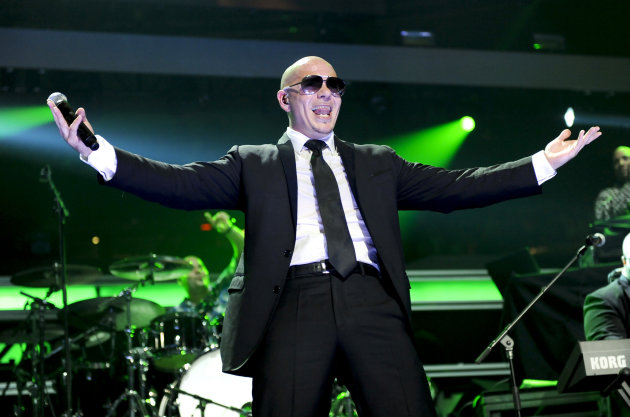 FILE - In this Dec. 9, 2011 file photo, rapper Pitbull performs at Z100&#39;s Jingle Ball concert at Madison Square Garden in New York. For years, the main route to fame for Latin music artists in the United States was win over mainstream audiences by singing in English, or build a Latin American fan base in Spanish and then break into the U.S. market. Now a growing group of artists like Pitbull, Prince Royce and Romeo Santos are making it big by singing in Spanish and English. (AP Photo/Evan Agostini, file)