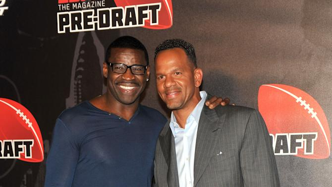 Andre Reed, right, and Michael Irvin attend the 9th annual ESPN The Magazine Pre-Draft Party at The Waterfront in New York, Wednesday, April 25, 2012, held on the eve of the NFL Draft.  (Diane Bondareff/AP Images for ESPN The Magazine)