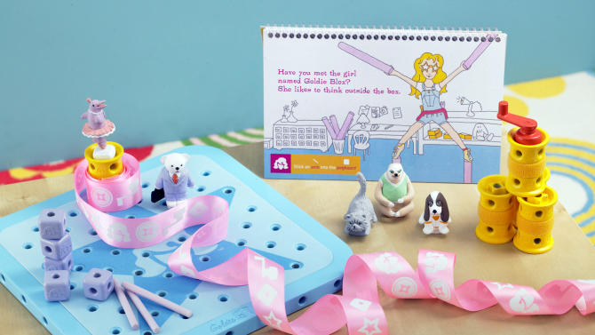 """This August 2012 photo released by GoldieBlox, Inc., shows the toy items from """"GoldieBlox and the Spinning Machine,"""" photographed in San Francisco. The toy's main character is a female engineer named Goldie, and is designed to spark an interest by girls in science and engineering. It is scheduled to be on store shelves in April 2013. (AP Photo/Susan Burdick)"""