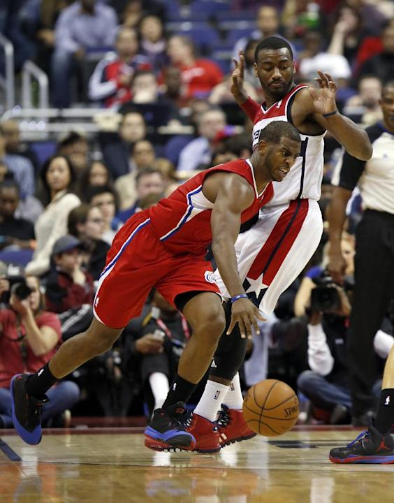 Los Angeles Clippers guard Chris Paul (3) drives past Washington Wizards guard John Wall (2) in the second half of an NBA basketball game, Saturday, Dec. 14, 2013, in Washington. The Clippers won 113-