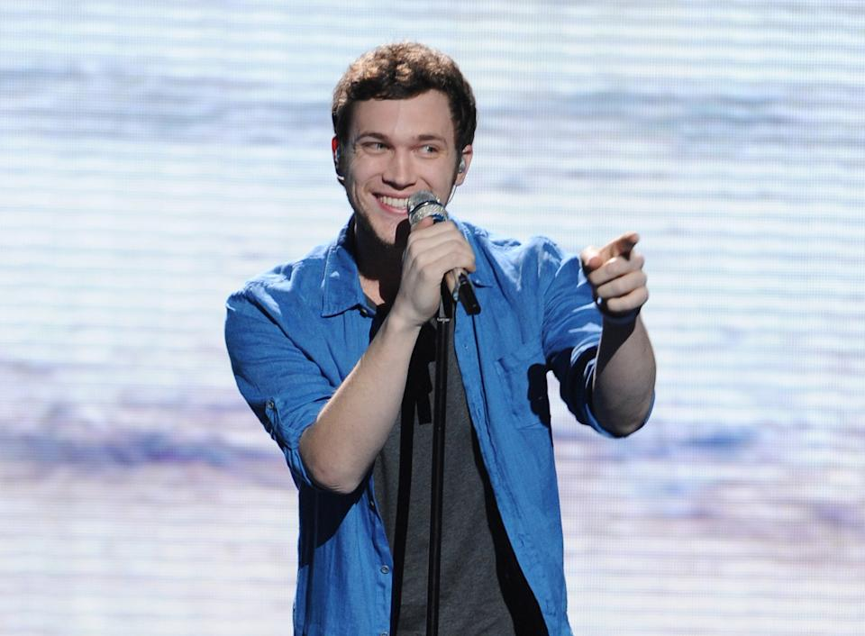 "In this May 9, 2012 photo released by Fox, contestant Phillip Phillips performs on the singing competition series ""American Idol,"" in Los Angeles. (AP Photo/Fox, Michael Becker)"