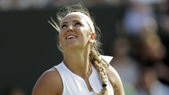 Victoria Azarenka of Belarus reacts during her match against Kristina Mladenovic of France at the Wimbledon Tennis Championships in London