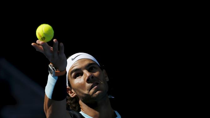Rafa Nadal of Spain serves a ball against Fabio Fognini of Italy during their men's singles semifinal match at the China Open tennis tournament in Beijing