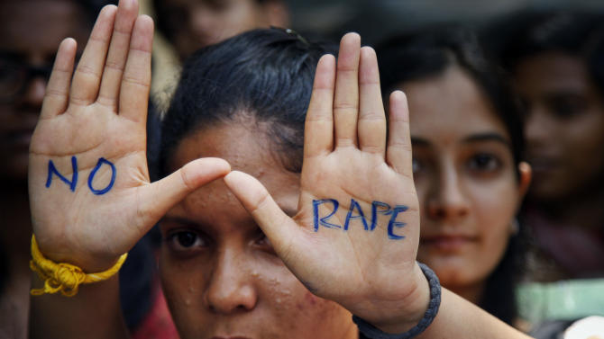 """An Indian student displays """"NO RAPE"""" message painted on her hands during a demonstration to demand death sentence for four men convicted of rape and murder of a student on a moving bus in New Delhi bus last year, in Hyderabad, India, Friday, Sept. 13, 2013. A judge on Friday ordered all four to the gallows for a brutal attack that left the young woman with such severe internal injuries that she died two weeks later. (AP Photo/Mahesh Kumar A.)"""
