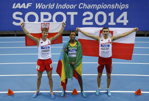 Medallist Poland's Lewandowski and Kszczot and Ethopia's Aman celebrate after men's 800m final at world indoor athletics championships in Sopot