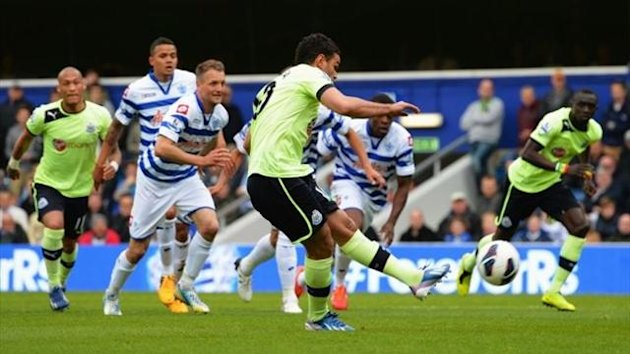 Hatem Ben Arfa of Newcastle United scores their first goal from the penalty spot during the Barclays Premier League match between Queens Park Rangers and Newcastle United at Loftus Road on May 12, 2013 in London, England