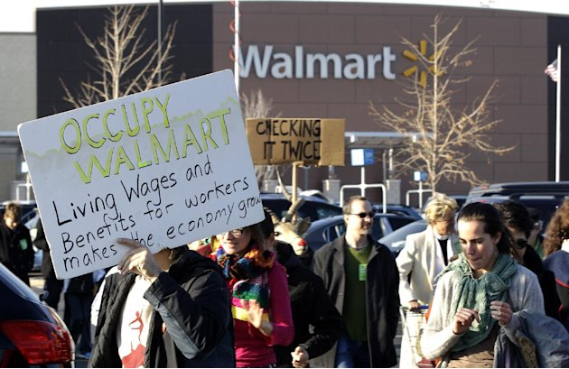 People protest against Wal-Mart on Black Friday, Nov 23, 2012, in Secaucus, N.J.  Wal-Mart employees and union supporters are taking part in today's nationwide demonstration for better pay and benefit