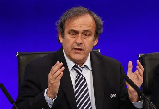 UEFA President Michel Platini welcomes the delegates as he opens the 37th Ordinary UEFA Congress in London, Friday, May 24, 2013