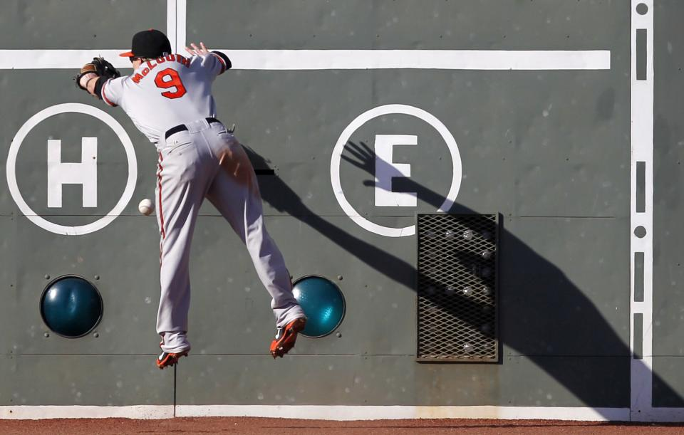 Baltimore Orioles' Nate McLouth can not make the catch on a double by Boston Red Sox's Scott Podsednik in the eighth inning of a baseball game in Boston, Saturday, Sept. 22, 2012. (AP Photo/Michael Dwyer)