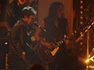 File photo of Lou Reed, U.S. rock singer and sobgwriter performing a song with the U.S. heavy-metal group 'Metallica' to promote their joint new album 'Lulu' in a Cologne TV studio November 11, 2011. REUTERS/Wolfgang Rattay/Files