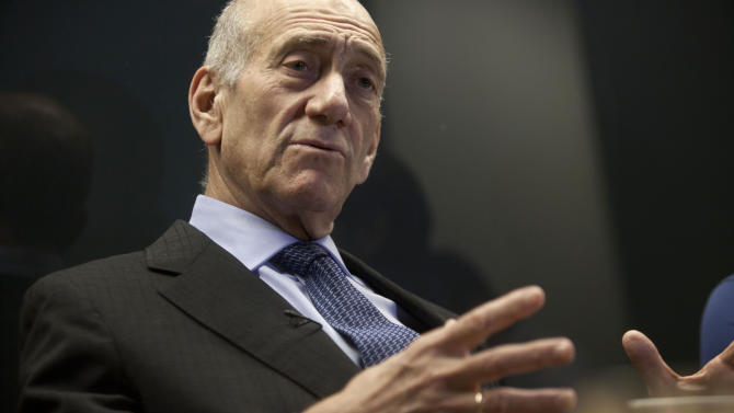 "Former Israel Prime Minister Ehud Olmert  speaks during an interview with The Associated Press in Tel Aviv, Israel, Thursday, April 18, 2013. In an interview with The Associated Press, Olmert said he will serve as chairman of the advisory board of ""Genesis Angels"" _ a venture capital firm focusing on early stage investment in startup companies. The firm looks toward innovations in robotics, augmented reality, artificial intelligence and other cutting edge technologies. (AP Photo/Dan Balilty)"