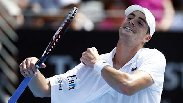 John Isner of U.S. reacts during his men's singles match against compatriot Ryan Harrison at the Sydney International