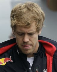 German Red bull driver Sebastian Vettel arrives for the German Formula One Grand Prix in Hockenheim, Germany, Sunday, July 22, 2012. (AP Photo/Frank Augstein)